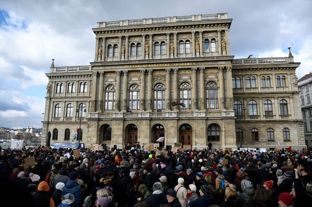 FILE PHOTO: People gather outside the Hungarian Academy of Sciences to protest against government plans to weaken the institution in Budapest, Hungary, February 12, 2019. REUTERS/Tamas Kaszas/File Photo