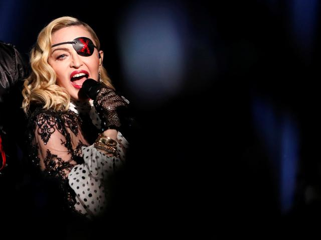 FILE PHOTO: 2019 Billboard Music Awards- Show - Las Vegas, Nevada, U.S., May 1, 2019 - Madonna performs with Maluma (not shown). REUTERS/Mario Anzuoni/File Photo