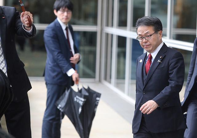 FILE PHOTO - Japan's Minister of Economy, Trade and Industry Hiroshige Seko leaves the European Commission headquarters after a meeting on steel overcapacity, in Brussels, Belgium March 10, 2018. REUTERS/Francois Walschaerts