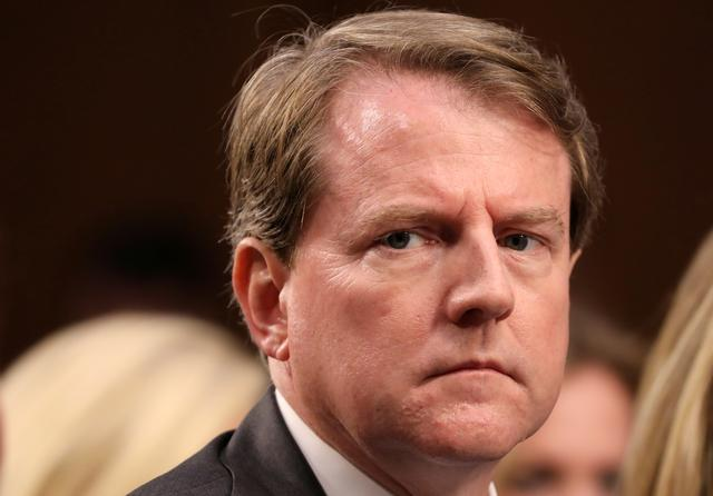 FILE PHOTO: White House Counsel Don McGahn listens during the confirmation hearing for U.S. Supreme Court nominee judge Brett Kavanaugh on Capitol Hill in Washington, U.S., September 4, 2018. REUTERS/Chris Wattie/File Photo - RC160C979C90
