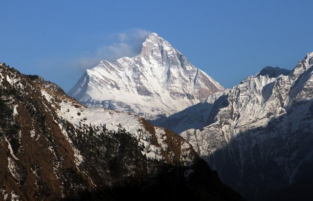 FILE PHOTO: Snow-covered Nanda Devi mountain is seen from Auli town, in the northern Himalayan state of Uttarakhand, India February 25, 2014. Picture taken February 25, 2014. REUTERS/Stringer