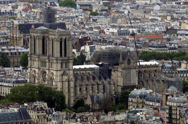 FILE PHOTO: A view shows Notre-Dame Cathedral after a massive fire devastated large parts of the gothic structure in Paris, France, May 10, 2019. REUTERS/Gonzalo Fuentes