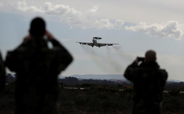 FILE PHOTO: A NATO AWACS (Airborne Warning and Control Systems) aircraft approaches the Air Base number 5 during the Real Thaw 2018 exercise in Monte Real, Portugal February 6, 2018. REUTERS/Rafael Marchante/File Photo
