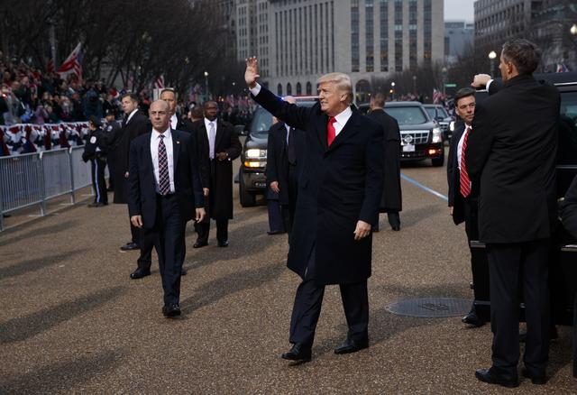 FILE PHOTO: President Donald Trump waves as he walks near the White House in the inaugural parade after being sworn in as the 45th President of the United States, Friday, Jan. 20, 2017, in Washington.  REUTERS/Evan Vucci/Pool