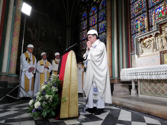 The Archbishop of Paris Michel Aupetit leads the first mass in a side chapel two months to the day after a devastating fire engulfed the Notre-Dame de Paris cathedral, in Paris, France June 15, 2019. Karine Perret/Pool via REUTERS