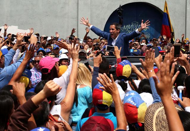Venezuelan opposition leader Juan Guaido, who many nations have recognised as the country's rightful interim ruler, greets supporters after delivering a speech, in Merida, Venezuela June 15, 2019. REUTERS/Carlos Eduardo Ramirez