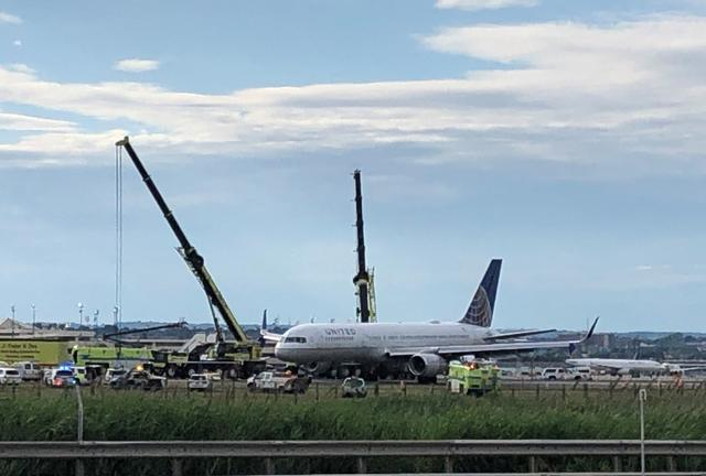 The United Airlines flight 627 plane is pictured disabled on the runway after its tires blew when it landed in New Jersey's Newark airport, US., June 15, 2019. REUTERS/Ed Tobin