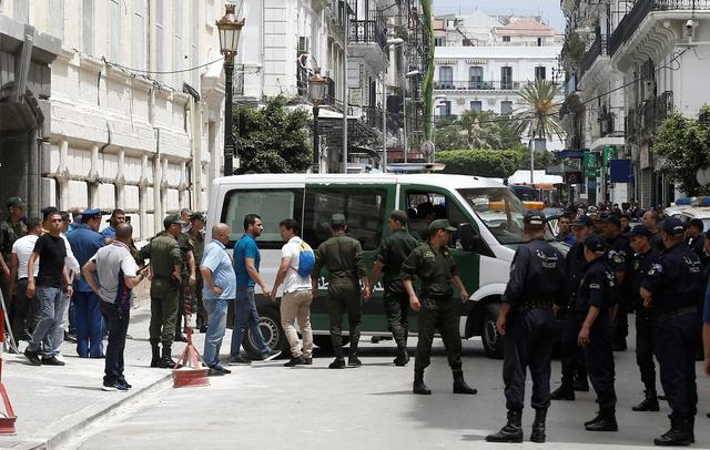 Police officers and members of national gendarmerie stand guard outside a court in Algiers, Algeria June 16, 2019. REUTERS/Ramzi Boudina