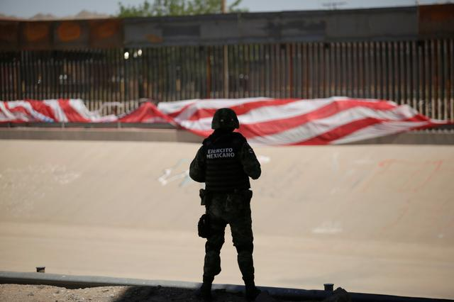 A Mexican soldier keeps watch at the border during an operation to inhibit migrants to cross illegally into the United States, according to local media, in Ciudad Juarez, Mexico June 16, 2019. REUTERS/Jose Luis Gonzalez