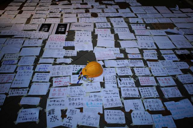 A helmet and messages of support for the protest against a proposed extradition bill, are seen displayed early morning in Hong Kong, China June 17, 2019. REUTERS/Athit Perawongmetha