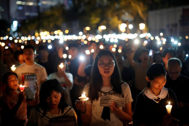 FILE PHOTO: Thousands of people take part in a candlelight vigil to mark the 30th anniversary of the crackdown of pro-democracy movement at Beijing's Tiananmen Square in 1989, at Victoria Park in Hong Kong, China June 4, 2019. REUTERS/Tyrone Siu/File Photo