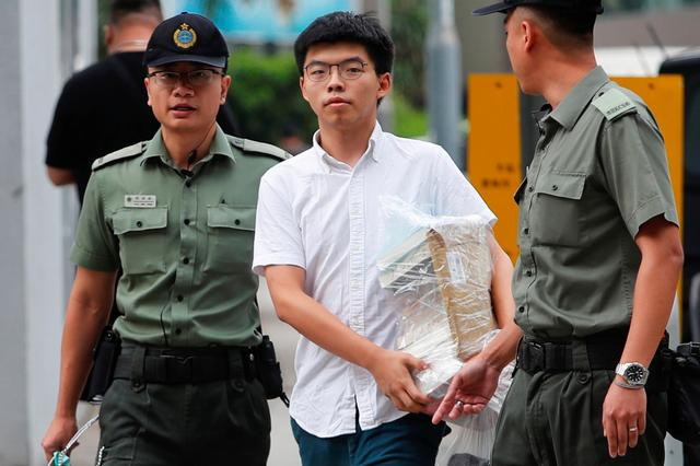 """Former student leader Joshua Wong walks out from prison after being jailed for his role in the Occupy Central movement, also known as """"Umbrella Movement"""", in Hong Kong, China, June 17, 2019. REUTERS/Tyrone Siu"""