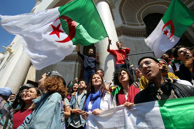 FILE PHOTO: Demonstrators hold flag during anti government protests in Algiers, Algeria April 23, 2019.   REUTERS/Ramzi Boudina