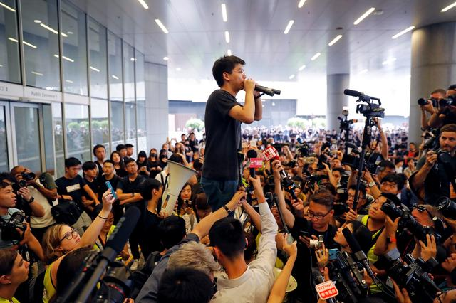 Pro-democracy activist Joshua Wong addresses the crowds outside the Legislative Council during a demonstration demanding Hong Kong's leaders to step down and withdraw the extradition bill, in Hong Kong, China June 17, 2019. REUTERS/Jorge Silva