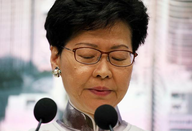 FILE PHOTO: Hong Kong Chief Executive Carrie Lam looks down during a news conference in Hong Kong, China, June 15, 2019. REUTERS/Athit Perawongmetha/File Photo