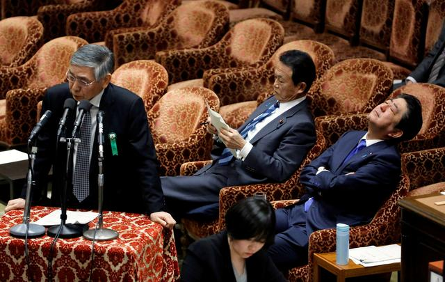 FILE PHOTO: Bank of Japan (BOJ) Governor Haruhiko Kuroda (L), Japan's Prime Minister Shinzo Abe and Deputy Prime Minister and Finance Minister Taro Aso attend a lower house budget committee session at the parliament in Tokyo, Japan, February 13, 2018.    REUTERS/Toru Hanai/File Photo