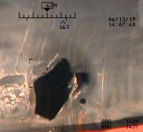 A U.S. military image released by the Pentagon in Washington on June 17, which is says was taken from a U.S. Navy MH-60R helicopter in the Gulf of Oman in waters between Gulf Arab states and Iran on June 13, shows mine blast damage to M/T Kokuka Courageous, a Japanese owned commercial motor tanker. Picture taken June 13, 2019.  U.S. Navy/Handout via REUTERS