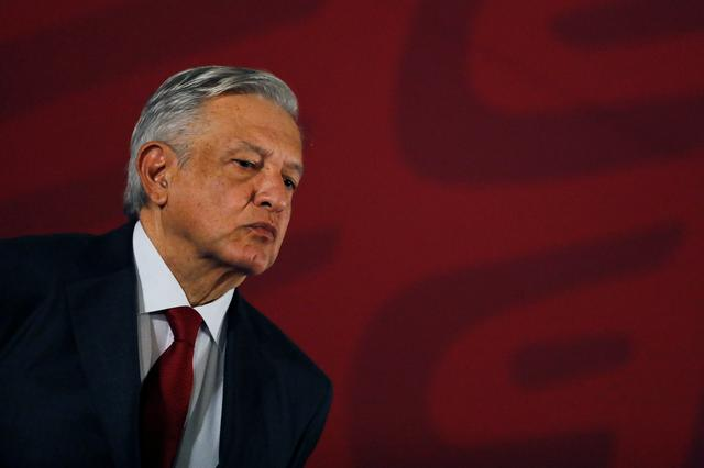 FILE PHOTO: Mexican president Andres Manuel Lopez Obrador looks on during a news conference at National Palace in Mexico City, Mexico, June 14, 2019. REUTERS/Carlos Jasso