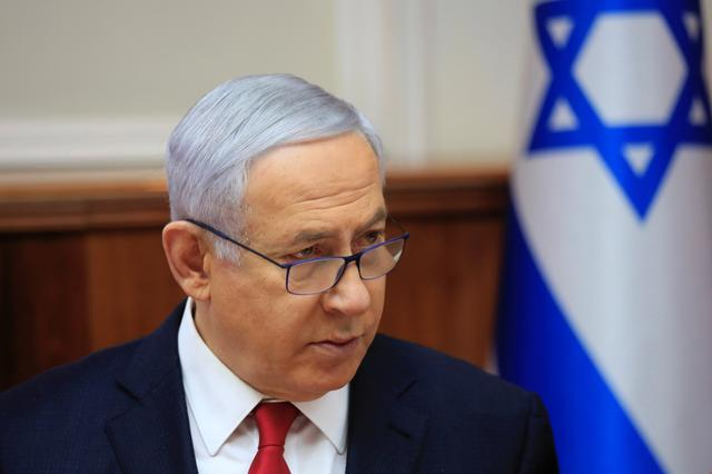FILE PHOTO - Israeli Prime Minister Benjamin Netanyahu speaks during the weekly cabinet meeting at the Prime Minister's office in Jerusalem May 19, 2019. Ariel Schalit/Pool via REUTERS *** Local Caption ***