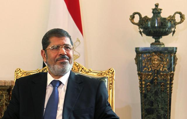 FILE PHOTO - Egypt's new Islamist President Mohamed Mursi attends a meeting with Tunisia's President Moncef Marzouki (not pictured) at the presidential palace in Cairo July 13, 2012. REUTERS/Amr Abdallah Dalsh/File Photo