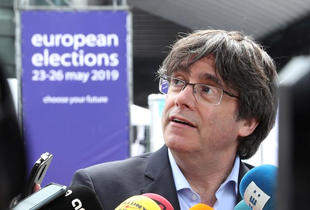 FILE PHOTO: Former Catalan President Carles Puigdemont talks to the media during European Parliament elections outside the EU Parliament in Brussels, Belgium May 26, 2019.  REUTERS/Yves Herman/File Photo