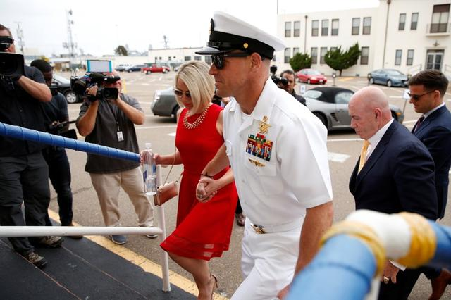 U.S. Navy SEAL Special Operations Chief Edward Gallagher leaves court with his wife Andrea after the first day of jury selection at the court-martial trial at Naval Base San Diego in San Diego, California , U.S., June 17, 2019.    REUTERS/Mike Blake