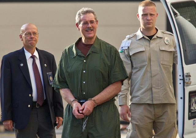 FILE PHOTO: Convicted financier Allen Stanford, who faces up to 230 years in prison for his $7 billion Ponzi scheme, arrives at Federal Court in Houston for sentencing June 14, 2012. REUTERS/Richard Carson/File Photo
