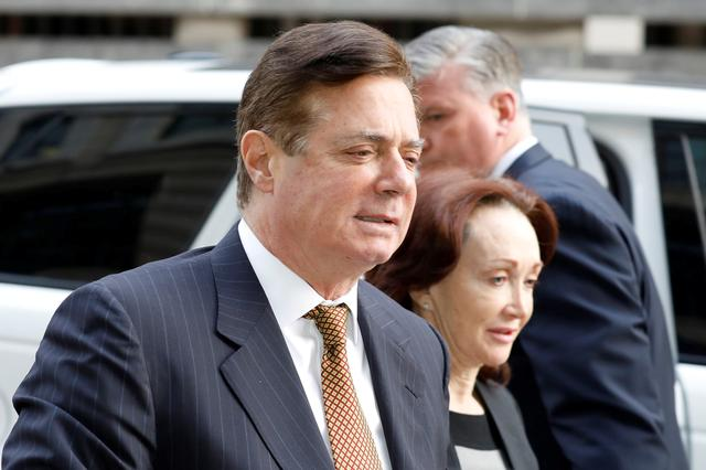 FILE PHOTO: U.S. President Trump's former campaign manager Paul Manafort arrives at a hearing at U.S. District Court in Washington, U.S., January 16, 2018. REUTERS/Yuri Gripas/File Photo
