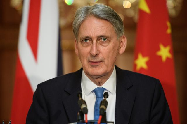 Britain's Chancellor Philip Hammond takes questions from the media following talks with China's Vice-Premier Hu Chunhua on economic and financial ties between the two countries in London, Britain June 17, 2019. Leon Neal/Pool via REUTERS