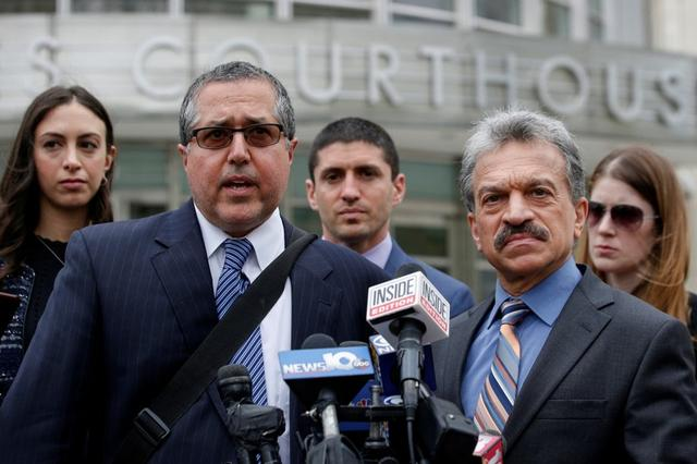 FILE PHOTO: Attorneys representing Nxivm leader Keith Raniere, Marc Agnifilo and Paul DerOhannesian, speak during a news conferrence following a hearing on charges of sex trafficking in relation to the Albany-based organization Nxivm at United States Federal Courthouse in Brooklyn, New York, U.S., May 4, 2018. REUTERS/Brendan McDermid/File Photo