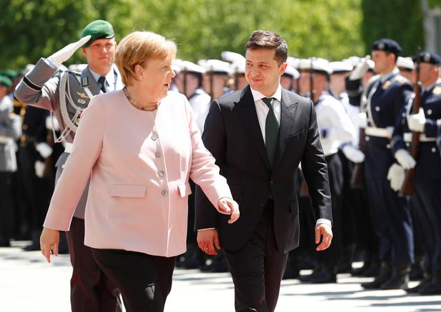German Chancellor Angela Merkel and Ukrainian President Volodymyr Zelenskiy meet at the Chancellery in Berlin, Germany, June 18, 2019. REUTERS/Hannibal Hanschke