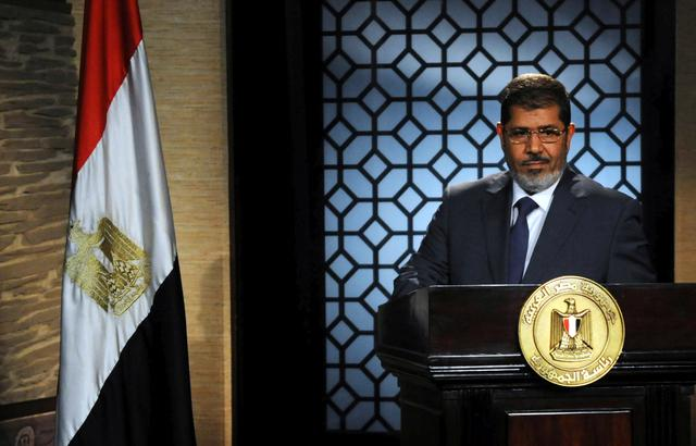 FILE PHOTO - Muslim Brotherhood's president-elect Mohamed Mursi speaks during his first televised address to the nation at the Egyptian Television headquarters in Cairo June 24, 2012.  REUTERS/Stringer