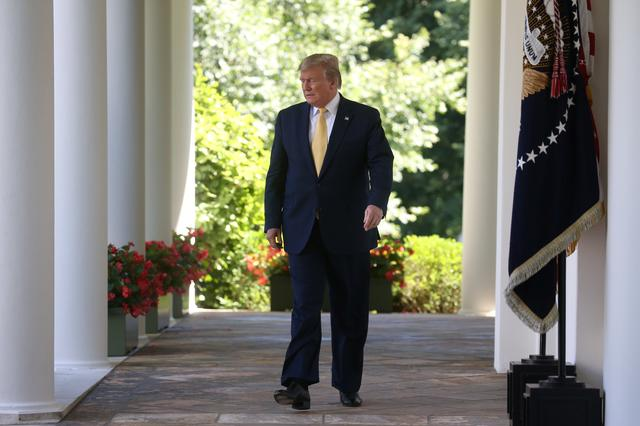 U.S. President Donald Trump arrives for an event on healthcare coverage options for small businesses and workers in the Rose Garden of the White House in Washington, U.S., June 14, 2019. REUTERS/Leah Millis