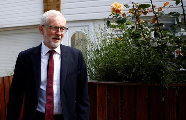 FILE PHOTO: Britain's opposition Labour Party leader Jeremy Corbyn leaves his home, following the results of the European Parliament elections, in London, Britain May 27, 2019. REUTERS/Henry Nicholls