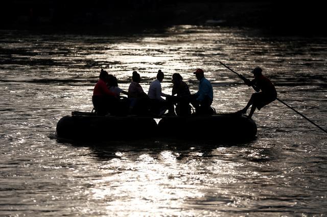 Migrants cross the Suchiate river on a raft from Tecun Uman, in Guatemala, to Ciudad Hidalgo, as seen from Ciudad Hidalgo, Mexico, June 13, 2019. REUTERS/Jose Cabezas
