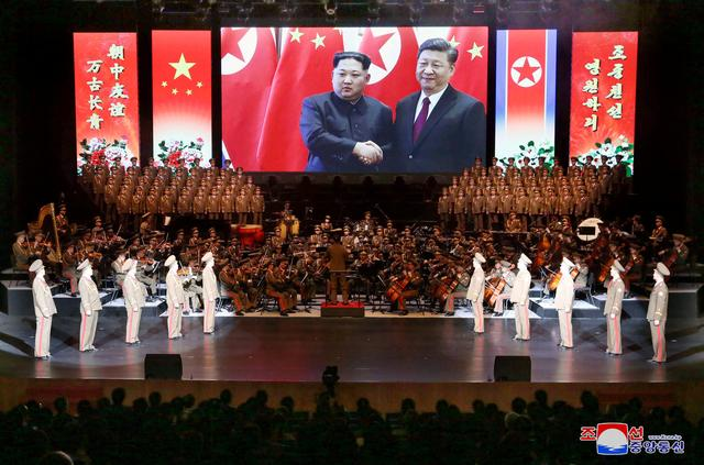 An image of North Korean leader Kim Jong Un and China's President Xi Jinping is displayed during a North Korean delegation's visit in Beijing, China, in this photo released by North Korea's Korean Central News Agency (KCNA) on January 30, 2019. KCNA via REUTERS