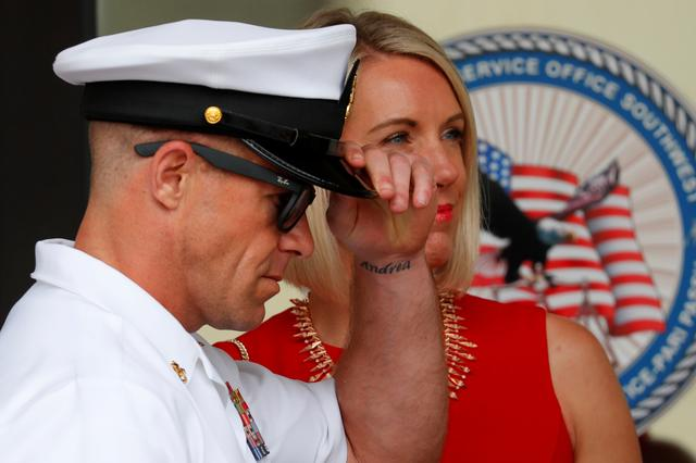 U.S. Navy SEAL Special Operations Chief Edward Gallagher leaves court with his wife Andrea, her name tattooed on his wrist, after the first day of jury selection at this court-martial trial at Naval Base San Diego in San Diego, California , U.S., June 17, 2019.    REUTERS/Mike Blake
