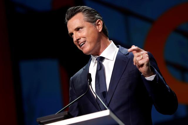FILE PHOTO: California's Governor Gavin Newsom speaks during the California Democratic Convention in San Francisco, California, U.S. June 1, 2019. REUTERS/Stephen Lam/File Photo