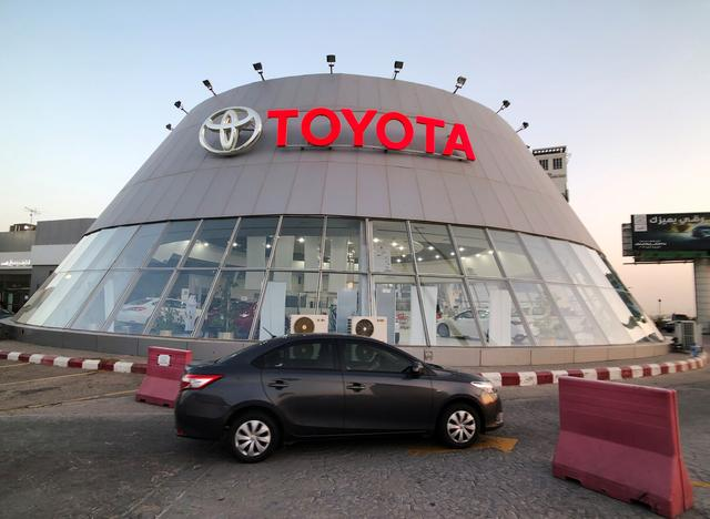 A car passes in front of Toyota dealer in Dhahran, Saudi Arabia June 15, 2019. Picture taken June 15, 2019. REUTERS/ Hamad I Mohammed