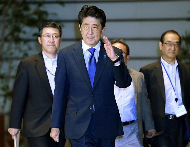 FILE PHOTO: Japan's Prime Minister Shinzo Abe arrives at his official residence after an earthquake, in Tokyo, Japan June 18, 2019, in this photo taken by Kyodo. Mandatory credit Kyodo/via REUTERS