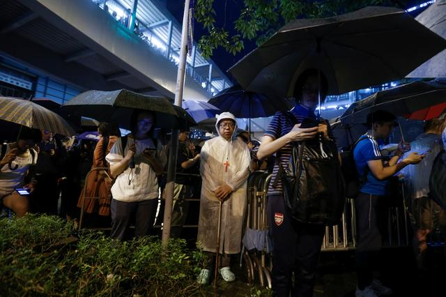 Faithful sing religious songs outside the Legislative Council building as they protest a proposed extradition bill with China in Hong Kong, China June 11, 2019. Picture taken June, 11 REUTERS/Thomas Peter