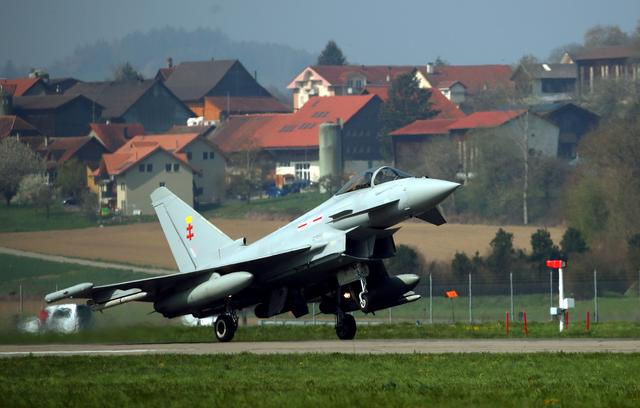 FILE PHOTO: A Eurofighter Typhoon jet lands after tests organised by Armasuisse to replace the fighter jets of the Swiss Air Force in Payerne, Switzerland April 12, 2019. REUTERS/Denis Balibouse/File Photo