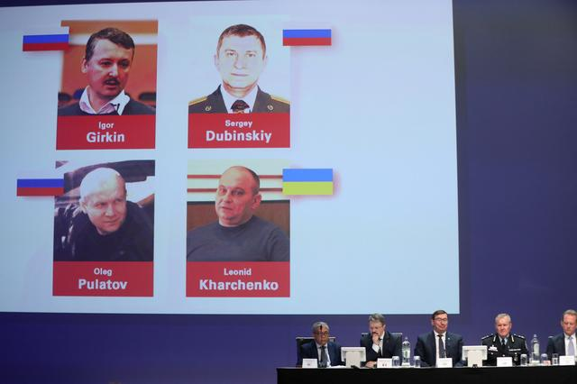 Russian nationals Igor Girkin, Sergey Dubinskiy and Oleg Pulatov, as well as Ukrainian Leonid Kharchenko, accused of downing of flight MH17, are shown on screen as international investigators present their latest findings in the downing of Malaysia Airlines flight MH17, nearly five years after the crash that killed 298 passengers and crew, in Nieuwegein, Netherlands, June 19, 2019.  REUTERS/Eva Plevier