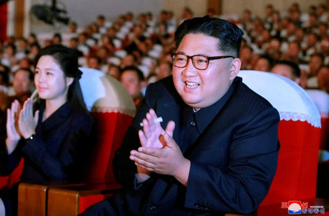 North Korean leader Kim Jong Un and his wife Ri Sol Ju watch a performance given by amateur art groups of the wives of officers of units of the Korean People's Army (KPA) selected in the seventh round of the second-term contest of art groups of KPA officers' wives, North Korea, in this undated photo released June 3, 2019 by North Korea's Korean Central News Agency (KCNA) in Pyongyang. KCNA/via REUTERS
