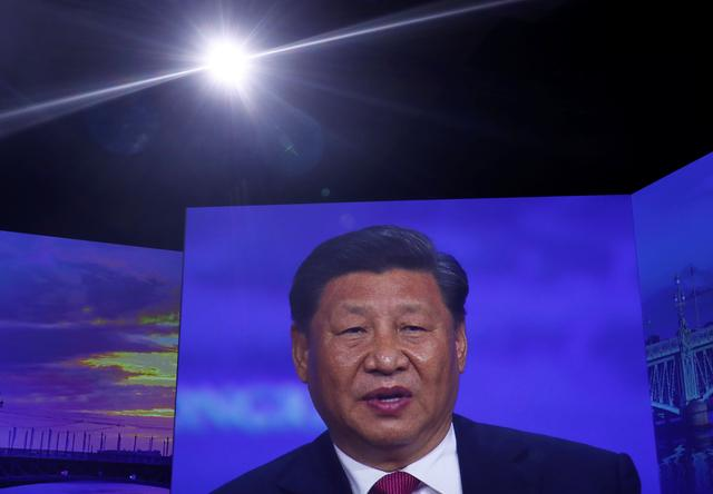 Chinese President Xi Jinping is seen on a screen while delivering a speech during a session of the St. Petersburg International Economic Forum (SPIEF), Russia June 7, 2019. REUTERS/Maxim Shemetov