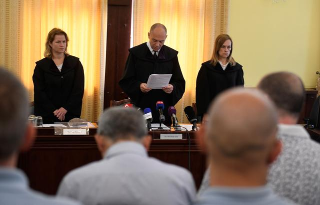 People smugglers responsible for the deaths of 71 men, women and children whose decomposing bodies were found crammed inside a truck dumped on an Austrian motorway in August 2015, listen to judge Erik Mezolakias he announces the final verdict and reasoning in a court in Szeged, Hungary June 20, 2019. REUTERS/Tamas Kaszas
