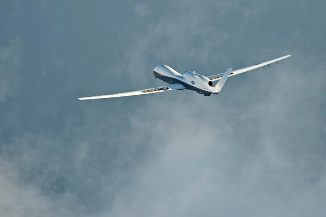 FILE PHOTO: The MQ-4C Triton unmanned aircraft system completes its inaugural cross-country ferry flight at Naval Air Station Patuxent River, U.S., September 18, 2014. U.S. Navy/Handout via REUTERS
