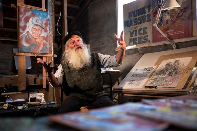 FILE PHOTO: Michael Netzer, an American comics artist formerly named Mike Nasser, gestures during his interview with Reuters at his attic studio in his home in the Jewish settlement of Ofra in the Israeli-occupied West Bank May 28, 2019. REUTERS/Ronen Zvulun