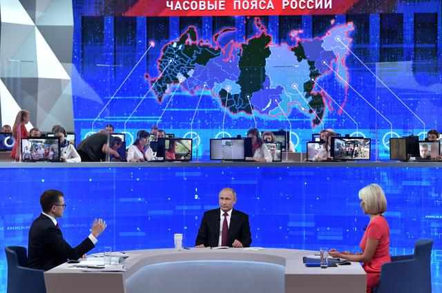 Russian President Vladimir Putin (C) attends an annual nationwide televised phone-in show in Moscow, Russia June 20, 2019. Sputnik/Alexey Nikolsky/Kremlin via REUTERS