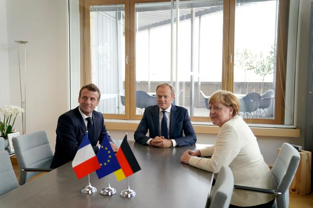 French President Emmanuel Macron, European Council President Donald Tusk and German Chancellor Angela Merkel attend a meeting prior the European Union leaders summit in Brussels, Belgium, June 20, 2019. Kenzo Tribouillard/Pool via REUTERS